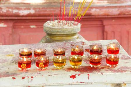 Votive candles and incense,  Emperor Jade Pagoda, Chua Phouc Hai pagoda, Saigon (Ho Chi Minh City),  Vietnam Banco de Imagens - 48931436