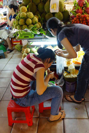 quick snack: SAIGON - FEB 5, 2015 - Market vendor takes time for a quick lunch at the Ben Thanh market, Saigon (Ho Chi Minh City), Vietnam
