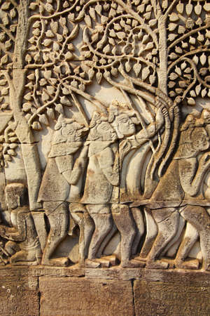 bas: Archers fight in battle between Khmer and Cham,  bas relief sculpture in Bayon, Angkor Thom,  Cambodia