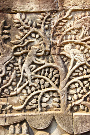bas: Monkeys in a tree,  bas relief sculpture in Bayon, Angkor Thom,  Cambodia Stock Photo