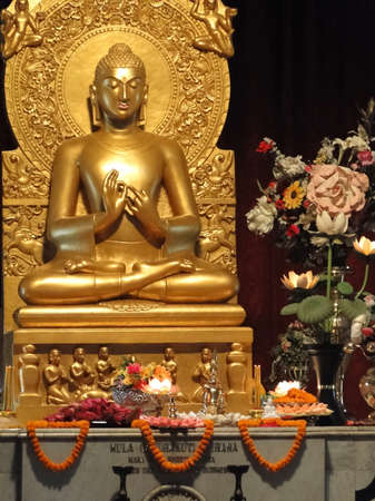 Statue of buddha teaching after enlightenment under the bodhi tree in Sarnath, India, Asia