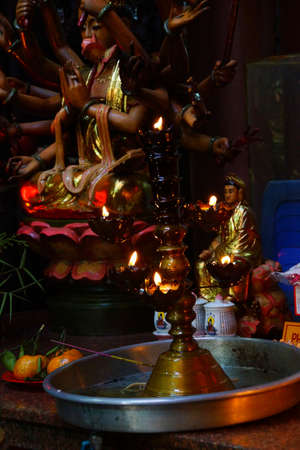 jade buddha temple: Votive candles and incense, with Buddha statue in the  Emperor Jade Pagoda, Chua Phouc Hai pagoda, Saigon (Ho Chi Minh City),  Vietnam Stock Photo