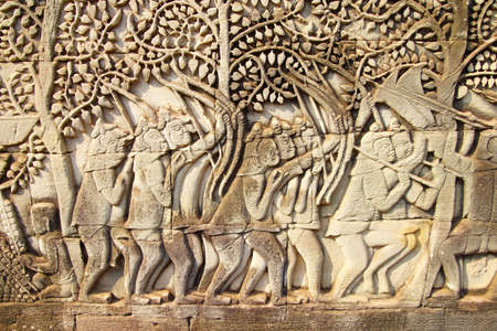 cambodia sculpture: Archers fight in battle between Khmer and Cham,  bas relief sculpture in Bayon, Angkor Thom,  Cambodia