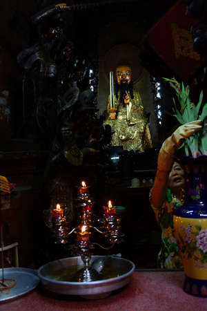 Votive candles and incense, with Buddha statue in the  Emperor Jade Pagoda, Chua Phouc Hai pagoda, Saigon (Ho Chi Minh City),  Vietnam Editorial