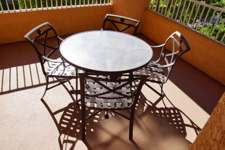 timeshare: Black patio table and chairs,  Rancho Mirage, California