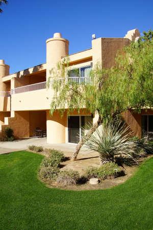 southwestern: RANCHO MIRAGE, CALIFORNIA - DEC 16, 2015 - Southwestern style hotel buildings in green oasis with Palm trees,  Rancho Mirage, California Editorial