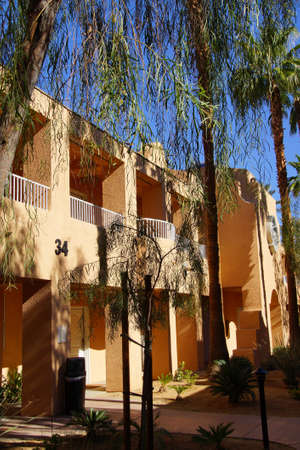 timeshare: RANCHO MIRAGE, CALIFORNIA - DEC 16, 2015 - Southwestern style hotel buildings in green oasis with Palm trees,  Rancho Mirage, California Editorial