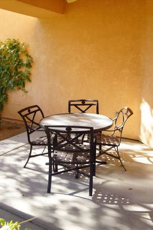 a mirage: Black patio table and chairs,  Rancho Mirage, California
