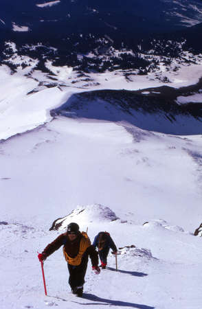mt  hood: MT HOOD, OREGON - MAY 5, 1972 - Climbers kicking steps up steep snow, WyEast Route, west side of Mt. Hood Pacific Northwest Editorial