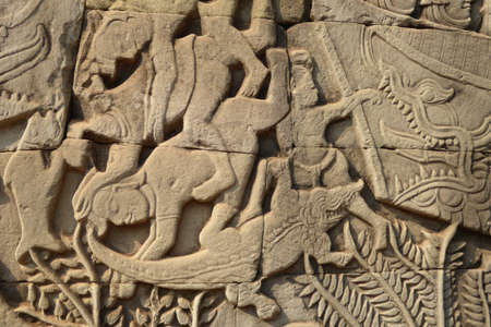 bas: Crocodiles eat sailors during a naval battle,  bas relief sculpture in Bayon, Angkor Thom,  Cambodia