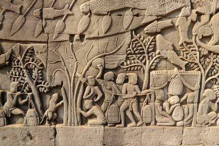 cambodia sculpture: Scenes from daily life,  bas relief sculpture in Bayon, Angkor Thom,  Cambodia