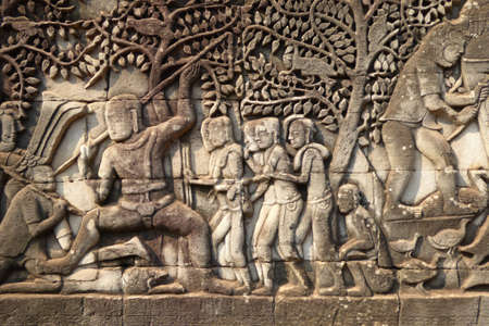 bas: Warriors marching  into battle, detail of bas relief sculpture in  Bayon, Angkor Thom,  Cambodia Stock Photo