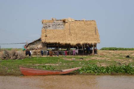 stilts: Fishing nets outside traditional house on stilts, Kompong Kleang floating fishing village,  Cambodia