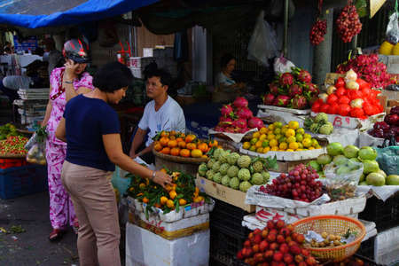 docs: CHAU DOC, VIETNAM - FEB 7, 2015 - Selling fruit at the open market,  in Chau Doc ,  Vietnam Editorial