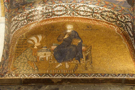 enthroned: ISTANBUL, TURKEY - MAY 15, 2014 - Enthroned Christ with the donor, Theodore Metochites wearing a skiadon turban,  mosaic,  Inner Narthex, Chora Church (Kariye Museum) in Istanbul, Turkey