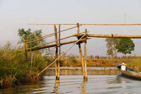 Bridge over a canal on  Inle Lake,  Myanmar (Burma) 免版税图像 - 52382122
