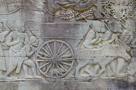 bullock: Bullock cart in procession,  bas relief sculpture in Bayon, Angkor Thom,  Cambodia