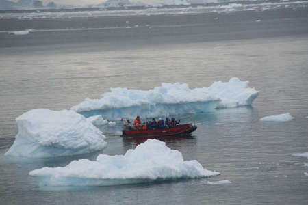 ANTARCTICA - DEC 12,  2006 -Polar landing boat returning tourists to cruise ship, ,Almirante Brown,Antarctica