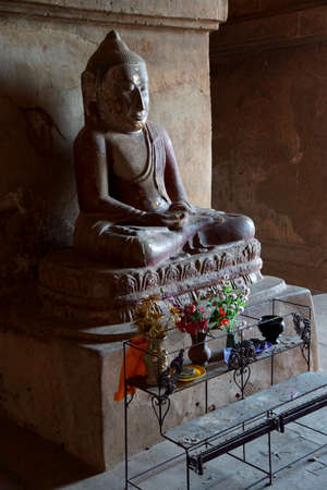bagan: BAGAN, MYANMAR - FEB 25, 2015 - Buddha statue in Dhammayangyi Temple, Bagan,  Myanmar (Burma)
