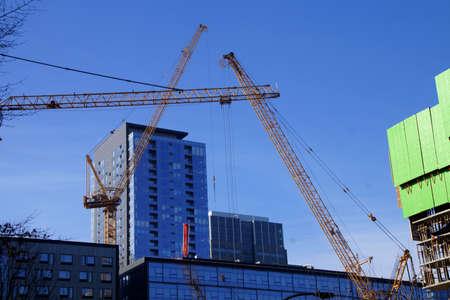 Hochhaus Bau Kräne in der Innenstadt von Seattle, Washington Standard-Bild - 53722858