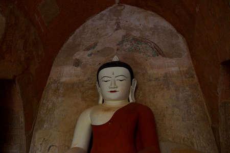 BAGAN, MYANMAR - FEB 25, 2015 - Buddha in Bhumiparsa Mudra position, Calling the Earth To Witness the Truth,Htilominlo Temple, Bagan,  Myanmar (Burma)