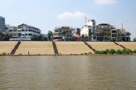 PHNOM PENH, CAMBODIA - FEB 8, 2015 - Buildings along quai of Mekong River , Cambodia