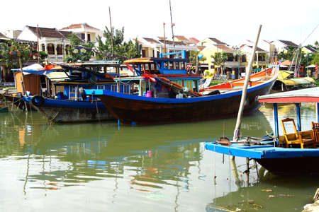 hoi an: Wooden boats in the canal of  Hoi An, Vietnam