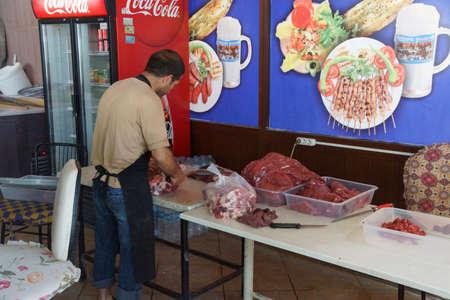 APHRODISIAS, TURKEY, - MAY 26, 2014 - Butcher preparing  kebabs for lunch in restaurant near  Aphrodisias,  Turkey