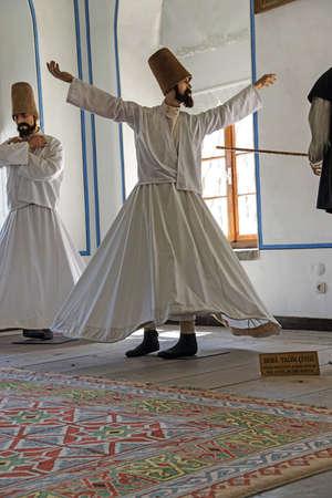 whirling: KONYA, TURKEY - JUN 3, 2014 - Whirling dervish school display at Mevlana shrine in  Konya, Turkey