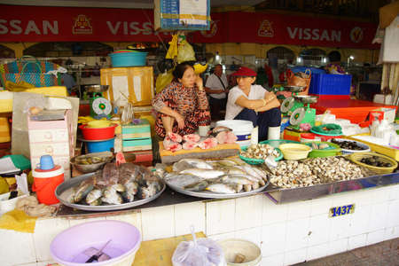 SAIGON - FEB 5, 2015 - Women selling fish at the Ben Thanh market in Saigon (Ho Chi Minh City),  Vietnam