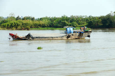 mekong: Working barges on the Mekong River,  Vietnam Stock Photo