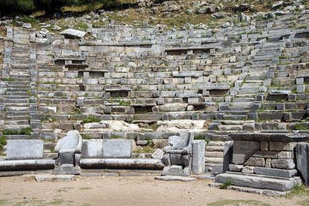 teatro antiguo: Ancient theatre with rows of stone seats,  Priene,  Turkey Foto de archivo