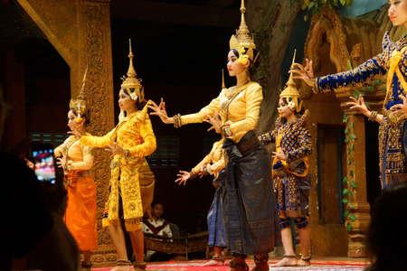 siem reap: SIEM REAP, CAMBODIA - FEB 14, 2015 - Line of apsara dancers perform at a recital,  Siem Reap,  Cambodia Editorial