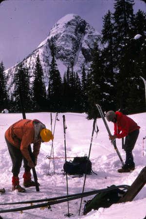 alberta: BANFF, ALBERTA - MAR 12, 1979 -Skiers preparing their skis in Alberta, Canada Editorial