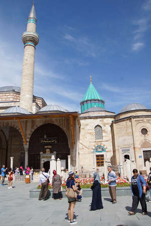 konya: KONYA, TURKEY - JUN 3, 2014 - Women and children cross the courtyard  of the Mevlana Shrine,  Konya, Turkey Editorial
