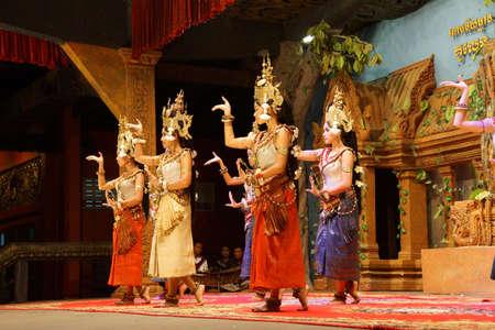 apsara: SIEM REAP, CAMBODIA - FEB 14, 2015 - Line of apsara dancers perform at a recital,  Siem Reap,  Cambodia Editorial