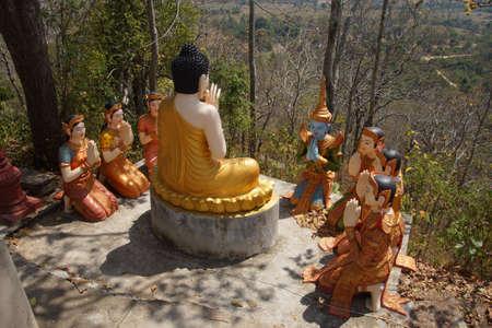 Statue of Buddha preaching to his disciples,  Sambuk Mountain Monastery, Kratie,  Cambodia Stock Photo