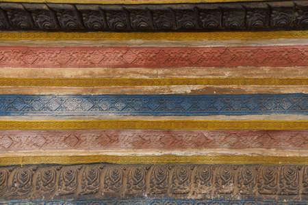 Decorative stucco panels at  Wat Bo Cambodia