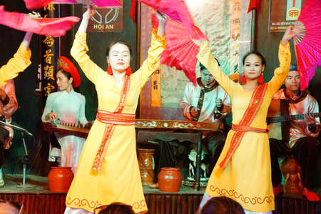hoi an: HOI AN, VIETNAM - FEB 3, 2015 - Women perform a traditional dance in   Hoi An, Vietnam