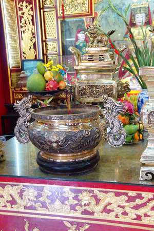 deity: HOI AN, VIETNAM - FEB 3, 2015 - Altar of a fertility deity,  Fukian Assembly Hall, Hoi An, Vietnam