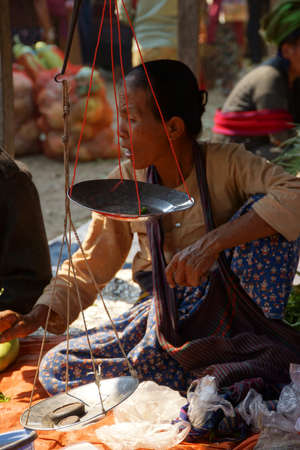 weekly market: INLE LAKE, MYANMAR - MAR 1, 2015 - Woman selling rice noodles at the weekly market on   Inle Lake,  Myanmar (Burma) Editorial