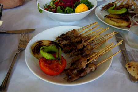 Plate of kebabs and salad for lunch, Aphrodisias,  Turkey Фото со стока