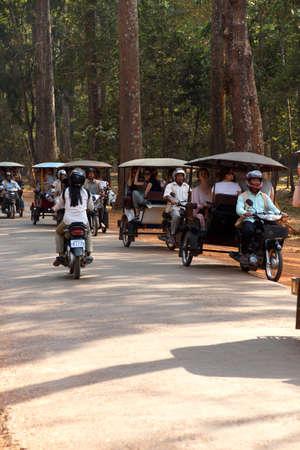 ANGKOR WAT, CAMBODIA - FEB 13, 2015 - Tuk tuks return tourists to their hotels, Angkor Wat,  Cambodia