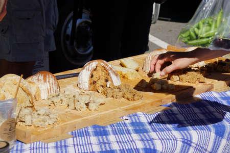 Cutting samples of bread for tasting at the  Saturday Market,  Penticton, British Columbia, Canada Stock fotó - 53737307