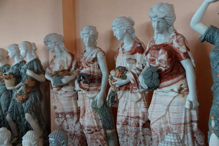craft on marble: DANANG, VIETNAM  - FEB 4, 2015 - Marble statues of Greek goddesses, with multicolored marble clothes,    Danang,  Vietnam