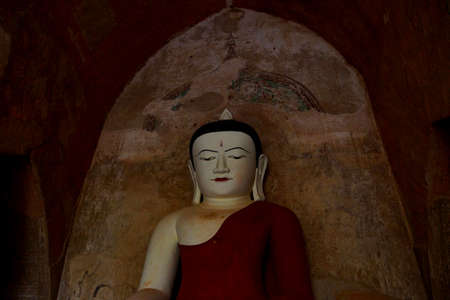 witness: BAGAN, MYANMAR - FEB 25, 2015 - Buddha in Bhumiparsa Mudra position, Calling the Earth To Witness the Truth,Htilominlo Temple, Bagan,  Myanmar (Burma)