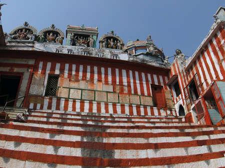 benares: VARANASI, INDIA - NOV 7, 2009 - Pilgrims climb the steps to the Shiva Temple of Kedara Ghat in Varanasi, India.