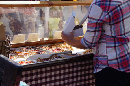 Woman serving pastries at the  Saturday Market,  Penticton, British Columbia, Canada Stock fotó - 53772544