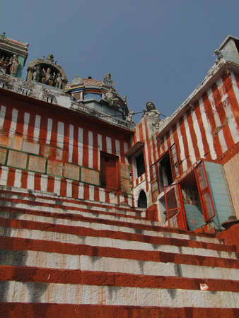 varanasi: VARANASI, INDIA - NOV 7, 2009 - Pilgrims climb the steps to the Shiva Temple of Kedara Ghat in Varanasi, India.