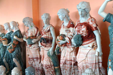 goddesses: DANANG, VIETNAM  - FEB 4, 2015 - Marble statues of Greek goddesses, with multicolored marble clothes,    Danang,  Vietnam